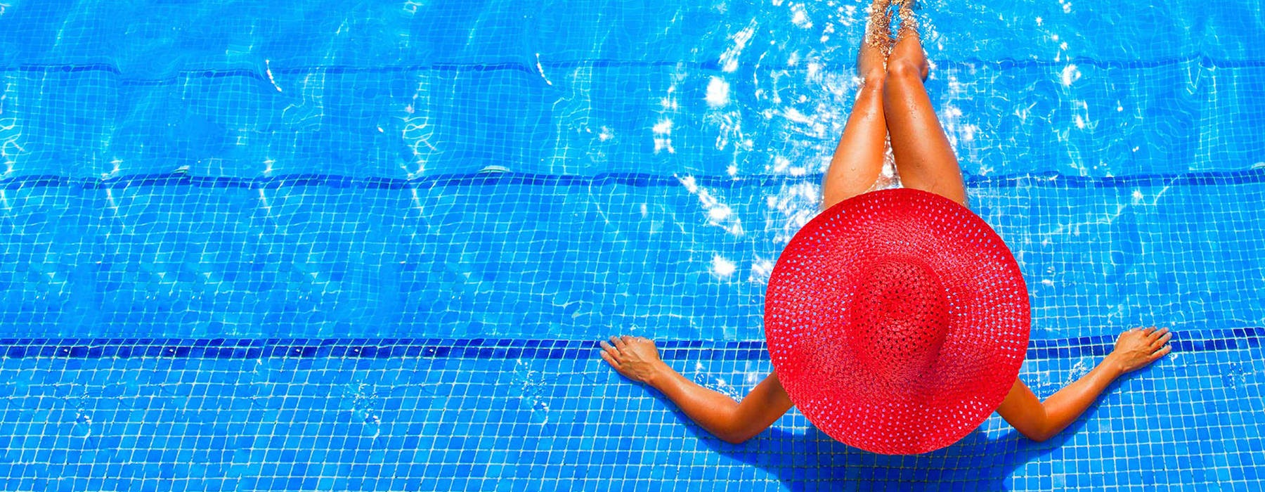 woman sitting on step in pool